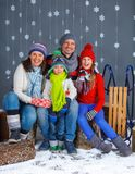 Funny family in winter clothes Stock Images