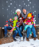 Funny family in winter clothes Royalty Free Stock Image