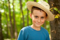 Funny farm boy in the forest Stock Photography