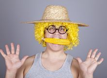 Funny farmer keep corn in mouth. Stock Image