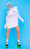 Funny fashion girl in hoodie and colored tights on a blue backgr Stock Images