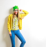 Funny Fashion Hipster Girl Smiling and Going Crazy. Funny Hipster Girl at White Wall Background. Street Syle Teenage Girl Smiling and Going Crazy. Trendy Casual royalty free stock image