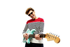 Funny fashion man playing on the guitar Royalty Free Stock Image