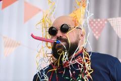 Funny fat man celebrating birthday. At home Royalty Free Stock Image