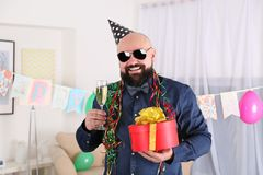 Funny fat man celebrating birthday. At home Stock Photography