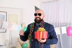 Funny fat man celebrating birthday. At home Royalty Free Stock Images