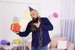 Funny fat man celebrating birthday. At home Stock Image