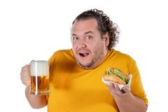 Funny fat man eating burger and drinking alcohol beverage on white background. Funny fat man eating burger and drinking alcohol beverage royalty free stock photo