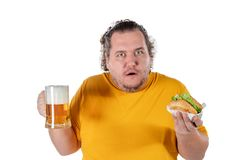 Funny fat man eating burger and drinking alcohol beverage on white background. Funny fat man eating burger and drinking alcohol beverage stock images