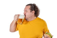 Funny fat man eating burger and drinking alcohol beverage on white background. Funny fat man eating burger and drinking alcohol beverage royalty free stock photos