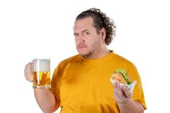 Funny fat man eating burger and drinking alcohol beverage on white background. Funny fat man eating burger and drinking alcohol beverage stock photos