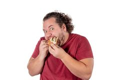 Funny fat man eating burger. Fast food, unhealty eat. Overweight and health problems stock image