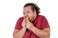 Funny fat man eating small croissant on white background. Good morning and breakfast stock photo