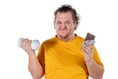 Funny fat man eating unhealthy food and trying to take exercise isolated on white background. Funny fat man eating unhealthy food and trying to take exercise royalty free stock photos