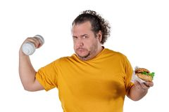 Funny fat man eating unhealthy food and trying to take exercise isolated on white background. Funny fat man eating unhealthy food and trying to take exercise stock photos