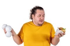 Funny fat man eating unhealthy food and trying to take exercise isolated on white background. Funny fat man eating unhealthy food and trying to take exercise stock image