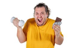 Funny fat man eating unhealthy food and trying to take exercise isolated on white background. Funny fat man eating unhealthy food and trying to take exercise royalty free stock image
