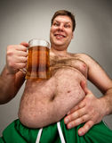 Funny fat man with glass of beer Royalty Free Stock Photography