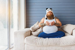 Funny fat man having unhealthy breakfast Royalty Free Stock Image