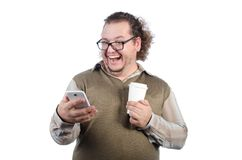 Fat happy guy and phone. Funny fat man. Long curly hair. White background. Isolated royalty free stock photography