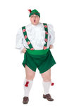 Funny fat man wearing German Bavarian clothes. Funny fat man wearing traditional German Bavarian clothes, isolated on white Royalty Free Stock Photography