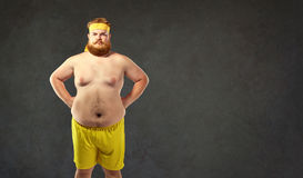 Funny fat naked man in sportswear. Funny fat naked men in sportswear. Humor and freak in sports Stock Photos