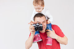 Funny father and child making selfie at vintage camera Royalty Free Stock Photos
