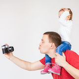 Funny father and child making selfie at vintage camera Royalty Free Stock Images