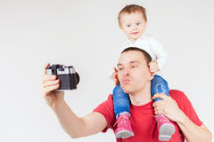 Funny father and child making selfie at vintage camera Stock Photo