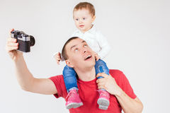 Funny father and child making selfie at vintage camera Stock Photography