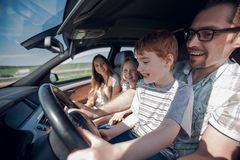 Funny father and his little son driving a car. The concept of parenting Royalty Free Stock Photography