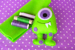 Funny felt monster, thread, felt sheets, scissors. Sewing concept stock image
