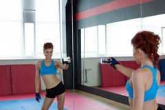Funny female athlete makes selfie in gym Stock Photos