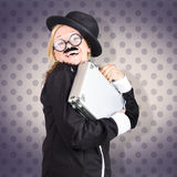 Funny female character in suit showing fun at work Royalty Free Stock Image