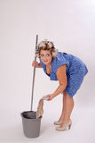 Funny Female Cleaner Holding Cleaning Materials Royalty Free Stock Photography