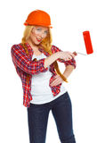 Funny female contruction worker  in a helmet with roller in hand Stock Image