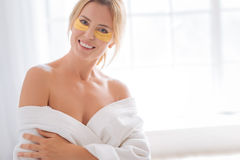Funny female feeling happiness while doing mask Stock Images