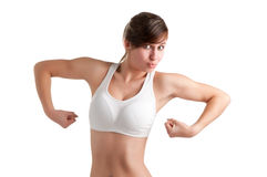 Funny Woman Posing. Funny female flexing her muscles, isolated in a white background Royalty Free Stock Images