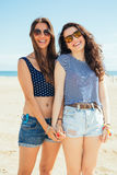 Funny female friends on the becha Stock Photos