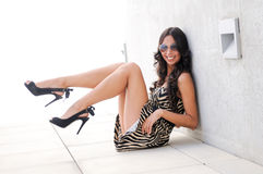 Funny Female model at fashion sitting on the floor Stock Photos