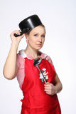 Funny female  posing with saucepan on the head Royalty Free Stock Photography