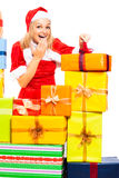 Funny female Santa opening Christmas gift Royalty Free Stock Photos