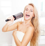 Funny female sing song in comb. Woman in the morning at bathroom. Funny female sing song in comb Royalty Free Stock Image