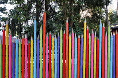 Funny fence painted as pencils Stock Photos