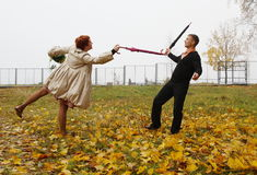 Funny fencing with umbrellas Royalty Free Stock Image