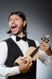 Funny fiddle violin player Stock Images
