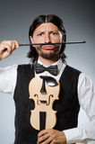 Funny fiddle violin player Stock Photo