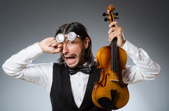 Funny fiddle violin player Royalty Free Stock Images