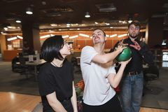 Fight of young people in bowling club. Stock Photos