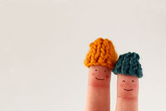 Funny finger people couple winter theme Stock Images